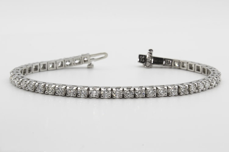 4. Try layering bracelets